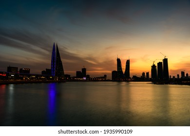 MANAMA, BAHRAIN - March 10, 2021: Beautiful silhouette view of iconic building Bahrain World Trade Center and Bahrain Financial Harbour during sunset