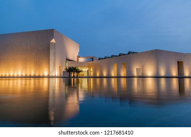 MANAMA, BAHRAIN - MARCH 15, 2017: View of Bahrain National Museum reflecting in a pond.