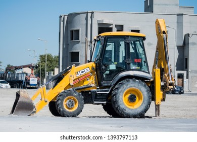 Manama, Bahrain - May 08, 2019: JCB heavy duty equipment vehicle parked on road side in Manama, Bahrain. JCB corporation is manufacturing equipment for construction and agriculture.