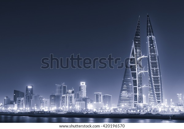 MANAMA, BAHRAIN - May 14: Bahrain World Trade Center Skyscraper and other tall high rise buildings  in Manama City. May 14-2016 in Manama, Kingdom of Bahrain - Cyanotype converted picture.