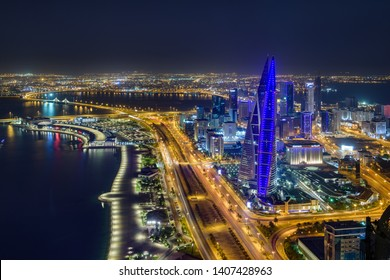 Manama, Bahrain - May 26, 2019: Panoramic view of Bahrain World Trade Centre building, Avenue mall and manama city illuminated at night.