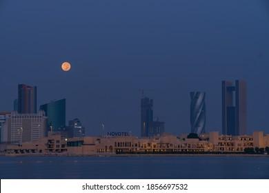 Manama, Bahrain - Moonset from Manama cityscape during early morning taken on Oct 2020
