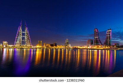 MANAMA, BAHRAIN - NOVEMBER 02, 2018: Panoramic view of iconic buildings Bahrain World Trade Center and Bahrain Financial Harbour with stunning reflections at night in Manama, Bahrain
