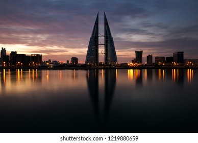 MANAMA, BAHRAIN - NOVEMBER 02: The Bahrain World Trade Center during sunrise, a twin tower complex is the first skyscraper in the world to have wind turbines, November 02, 2018, Manama, Bahrain