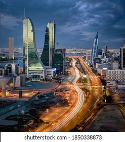 Manama, Bahrain - November 09, 2020: Aerial view of Manama skyline with iconic Bahrain Financial Harbour and Bahrain World Trade Center building during blue hour.