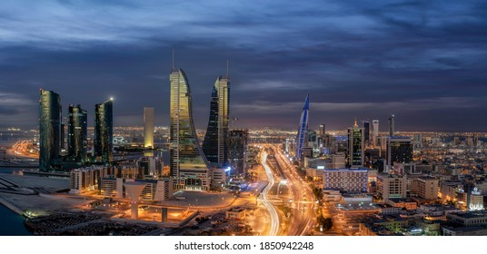 Manama, Bahrain - November 10, 2020: Panoramic view of Manama skyline with iconic Bahrain Financial Harbour and Bahrain World Trade Center building during blue hour.