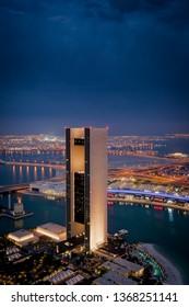 Manama, Bahrain - November 2018: Beautiful Aerial View of Four seasons hotel and Bahrain Bay at blue hour.