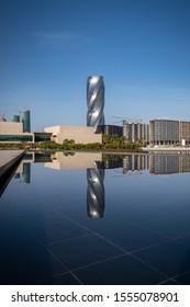 MANAMA, BAHRAIN - NOVEMBER, 2019: Beautiful view of United building/Wyndham Grand hotel Manama with reflection after sunrise, Manama, Bahrain.