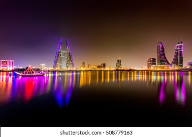 MANAMA, BAHRAIN - OCT 28, 2016: Beautiful and wide view of the Seafront with illuminated World Trade Center and other high rise buildings in the city.