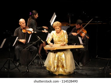 MANAMA, BAHRAIN - OCTOBER 01: Hasmik Leyloyan, the Queen of Qanun with her orchestra performs on October 01, 2012 in Bahrain on the occasion of the 21st Bahrain International music festival
