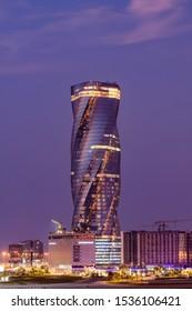MANAMA, BAHRAIN - OCTOBER 20, 2019: Beautiful view of United building/Wyndham Grand Manama with striking skyline after sunrise, Manama, Bahrain.