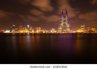 MANAMA, BAHRAIN - OCTOBER 28: The Bahrain World Trade Center & skyline during dusk, a twin tower complex is the first skyscraper in the world to have wind turbines, October 28, 2018, Manama, Bahrain