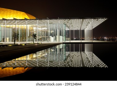 MANAMA, BAHRAIN-DECEMBER 19: The reflection beautiful illuminated porch of Bahrain National Theatre on December 19, 2014, Manama, Bahrain. This is one of largest theatre in Arab world with 1001 seats