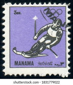MANAMA - CIRCA 1972: stamp printed by Manama, shows Downhill skiing athlete, Winter Olympic games, circa 1972