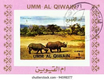 MANAMA QIWAIN- CIRCA 1972: a stamp printed by Qiwain shows rhino, series Wild Animals, circa 1972