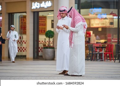 MANAMA/BAHRAIN - April 9, 2019: Two young arab men talking on the street