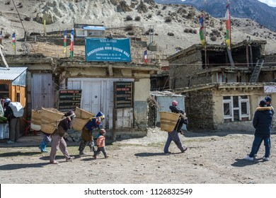 Manang village in the Himalayas, Nepal-05.04.2018: Women carry large heavy baskets on April 5, 2018 in the mountain village of Manang in the Himalayas , Nepal.