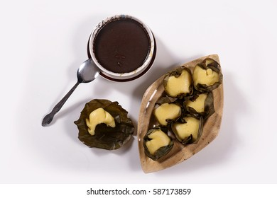 Manapla Puto or Steamed Rice Cake with Dinuguan or Pig's Blood Stew with an eaten piece. Top view shot.