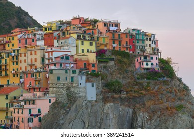 Manarola charming little fishing village at sunrise, colorful houses in Italy