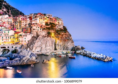 Manarola, Cinque Terre, Italy. Amazing night view of Manarola small fisherman village in Liguria, Mediterranean Sea.