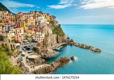 Manarola, Cinque Terre - romantic small village with colorful buildings on cliff overlooking sea. Cinque Terre National Park with rugged coastline is famous tourist destination in Liguria, Italy