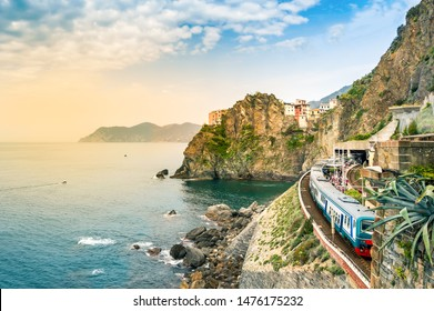 Manarola, Cinque Terre - train station in small village with colorful houses on cliff overlooking sea. Cinque Terre National Park with rugged coastline is famous tourist destination in Liguria, Italy