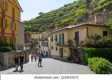 Manarola, Italy - April 29: Tourists exploring picturesque port town, on April 29 2018 in Manarola, Italy