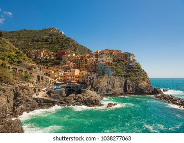 Manarola Italy, a city along the Cinque Terre on the Mediterranean Sea. Sunny, blue sky late in the day