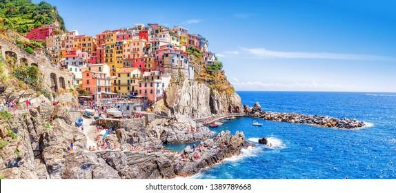 Manarola, Italy - iconic landmark village in Cinque Terre national park in Italy, Ligury, nearby Spezia city. UNESCO world heritage site. Manarola is famous and popular travel destination.