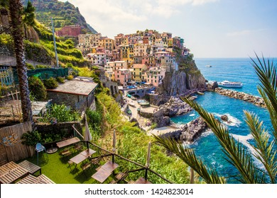 MANAROLA, ITALY - June 2019: Manarola aerial view, colorful houses on the cliff, Cinque Terre National Park, Liguria, Italy