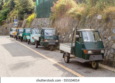 MANAROLA, ITALY - JUNE 30: Typical three wheels Piaggio Ape italian small pickup trucks in Manarola on June 30, 2015.
