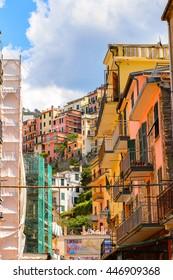 MANAROLA, ITALY - MAY 5, 2016: Main street and its architecture of Manarola (Manaea),  La Spezia, Liguria, Italy. It's one of the lands of Cinque Terre, UNESCO World Heritage Site