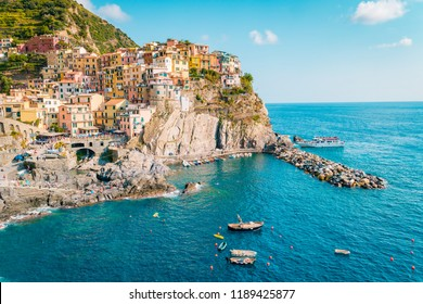 Manarola Village, Cinque Terre Coast of Italy. Manarola a beautiful small town in the province of La Spezia, Liguria, north of Italy and one of the five Cinque terre travel attractions, Sunset colors