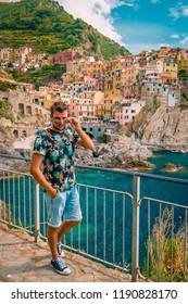 Manarola Village, Cinque Terre Coast Italy. Manarola colorful town province of La Spezia, Liguria, north of Italy and one of the five Cinque terre national park,man walking hiking trail mountain