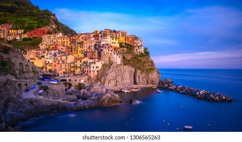 Manarola - Village of Cinque Terre National Park at ligurian coast of Italy. Beautiful colors at sunset. Province of La Spezia, Liguria, in the north of Italy, Europe.
