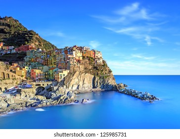 Manarola village on cliff rocks and sea at sunset., Seascape in Five lands, Cinque Terre National Park, Liguria Italy Europe. Long Exposure Photography.