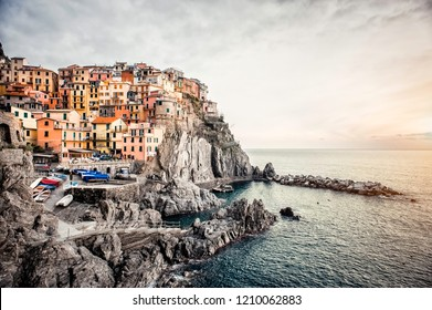 Manarola village. Manarola is small town in province of La Spezia, Liguria, northern Italy. Colored residential houses on top of rocky cliff mountain. Famous place, beautiful scenery surronded by sea