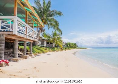 Manase Beach, Savai'i, Western Samoa, South Pacific - fale tourist accommodation next to sand and blue sea