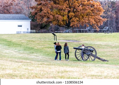 Manassas, USA - November 25, 2017: Old cannons in National Battlefield Park in Virginia where Bull Run battle was fought, people tourists