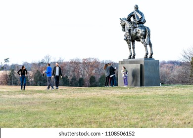 Manassas, USA - November 25, 2017: Statue of Stonewall Jackson and many tourists people in National Battlefield Park in Virginia where Bull Run battle was fought