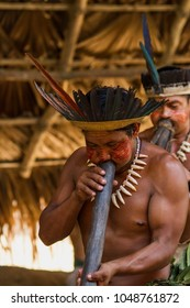 Manaus, Amazon / Brazil - August 06, 2011: Indigenous man blowing flutes durign a presentation at a Dessana indigenous community on a river island near from Manaus city.