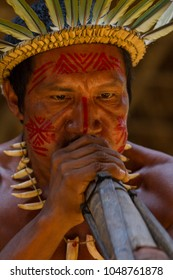 Manaus, Amazon / Brazil - August 06, 2011: Indigenous man blowing flutes during a presentation at a Dessana indigenous community on a river island near from Manaus city.
