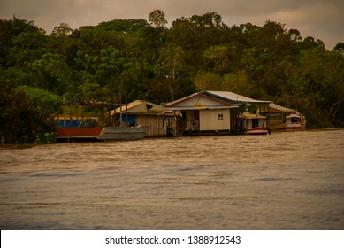 Manaus, Amazonas, Brazil: The merger of the two colored river, Rio Negro, Solimoes. Meeting, multi-colored waters do not mix, and continue the way side by side, thus each river remains with the own
