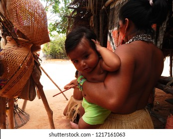 MANAUS, AMAZONIA/BRAZIL - AUGUST, 28, 2018 - mom holding baby indian from amazon in brazil