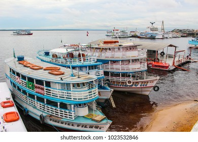 Manaus, Brazil - 2018-01-24 : Transportation boats or ferries on the Rio Negro in Manaus, Brazil, Amazonas, South America