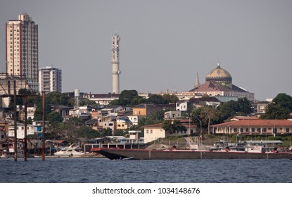 Manaus, Brazil - August 10 2010: The  Manaus skyline viewed from boat on the amazon river.