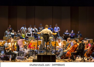 MANAUS, BRAZIL, MARCH 21: Orchestra conductor at work with music school students repeating their daily musical session at the Amazon Theatre. Manaus, Amazonas Brazil 2015