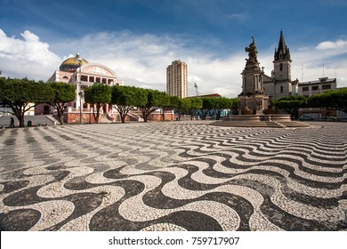 Manaus city sidewalk with Amazon theatre and church