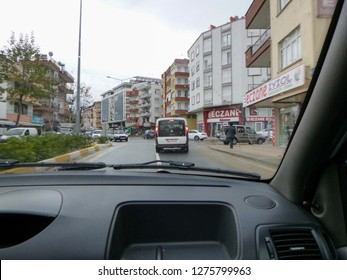 MANAVGAT, TURKEY - JANUARY 4 2018: On the road through Manavgat town and Sirtkoy village in Turkey. View from the car window