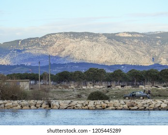 MANAVGAT, TURKEY - JANUARY 5 2018: Fishermen, car and the Manavgat River on the background of the Taurus Mountains